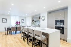 Beans on toast, anyone?Their open plan kitchen and breakfast rooms have stone worktops, frosted glass splash-backs and integrated appliances from German manufacturer Miele - whose steam ovens start at a cool £700