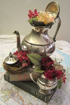 Teapot collage on book centerpiece with roses idea