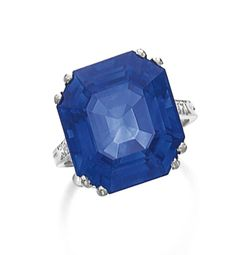 SAPPHIRE AND DIAMOND RING, BOUCHERON The octagonal step-cut sapphire weighing 21.60 carats, to single-cut diamond shoulders, size 54, signed Boucheron and numbered, French assay mark.