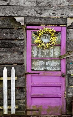 Dittmer, Missouri: adorable light purple door with lace curtain... makes you think a pitcher of lemonade is waiting inside!