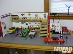 Small Scale Spotlight Mopar Diorama Garage Photo 1..the detail the guy used in making this diorama is incredible! I wonder where he found things like miniature paper towel dispensers and wall outlets.