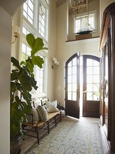 Two story foyer with double entry doors.