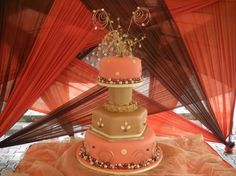 A beautiful mix of Nigerian traditional colors and contemporary design wedding cake from Cakes by Yosola