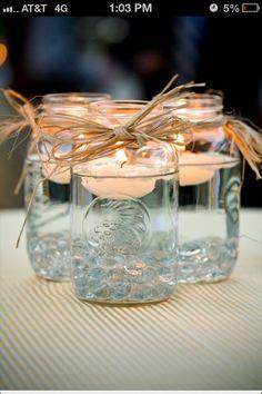 Mason jar centerpiece, add a Silver-grey ribbon. Perfect idea for the reception tables