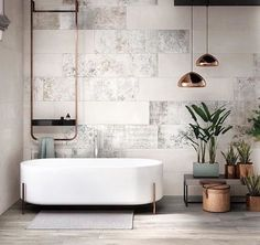 Wow this bath shape, legs and caddy. Ignore everything else, the styling looks like a show room. The plants themselves are lovely but I do not like how they're displayed.