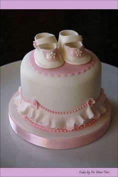 """Baby booties"" cake by Cakes by No More Tiers (York), via Flickr"
