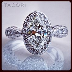 """MMMM is for Marquis! We adore this custom designed Tacori ring, which takes a Dantela framework for the Marquis shaped center stone, and puts in on the foundation of our 3D crescent band."" Via Tacori."