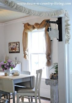 Landscape Burlap Swag Curtains No-Sew Landscape Burlap Curtain Swags in Farmhouse Dining Room. See how easy it is to make them!No-Sew Landscape Burlap Curtain Swags in Farmhouse Dining Room. See how easy it is to make them! Scarf Curtains, Diy Curtains, Curtains With Blinds, How To Make Curtains, Country Curtains, Burlap Window Treatments, Farmhouse Window Treatments, Window Coverings, Burlap Swag