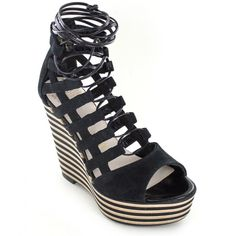 """<p>Italian+suede+platform+sandal+with+adjustable+laces,+cushioned+sock+and+leather+lining.+While+Dorothy+is+skipping+down+the+yellow+brick+road,+you+can+find+Glynda+on+the+runway+striking+a+pose.+Horizontal+striped+bottom+and+an+oh+so+sexy+silhouette+will+make+anyone+forget+about+ruby+slippers.+Heel+height:+5""""+Forepart+1.5""""</p> <p></p> <p><em>Please+click+""""View+Sizing+Guide''+link+to+access+product+specifications,+fit+tips+&+sizing+conversion+information.</em></p>"""
