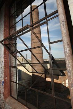 This is the JJ Rogers building in downtown Tupelo. It was the original cotton mill in Mill Village. This is the original smokestack. Photo courtesy of the Northeast Mississippi Daily Journal.