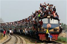 Winner – Best Single Image in the Exotic portfolio category: Tongi/northern border of Dhaka/Bangladesh. During the Muslim congregation, local residents arrived at and left the congregation by train. They climbed to top of the train and squeezed into every space they could find.    Photo: Yeow Kwang Yeo, TPOTY