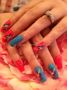 Pink and blue polish with one stroke freehand nail art over acrylic nails