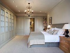 The uncluttered simplicity of this beautiful bedroom gives it a calm, serene ambiance.