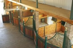 Love this horse barn, the stables are a different shape to normal and it creates a nice atmosphere for the horses and the owners to be in