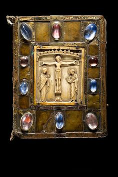 Gospel Book aka Small Bernward Gospel -- Last 1/3, 9th Century -- Front Cover: 2nd Half, 12th Century -- Northeast French & German -- Opaque gold pain, gold & silver on parchment; Binding & front cover: Leather, copper worked in vernis brun; gilded copper, rock crystal, paint on parchment under horn on oak. Byzantine ivory plaque -- Mepotrolitan Museum of ArtThis artwork is part of Medieval Treasures from Hildesheim at the Metropolitan Museum of Art.