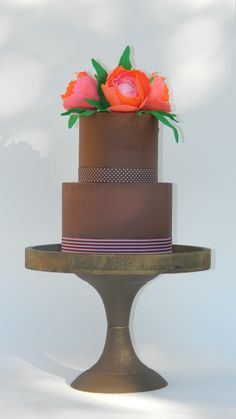 'Pride & Joy Cakes' - Chocolate cake layered and coated in a blend of milk and dark chocolate ganache;  Decorated with peony sugar flowers. https://www.facebook.com/341359299279171/photos/pcb.823745717707191/823745321040564/?type=3&theater