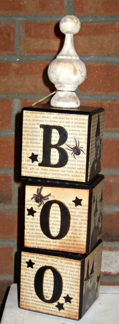 These BOO blocks are no longer for sale but would be easy to make with wood blocks, old book pages, scrapbook paper or music sheets. Stamp ink rubbed on gives it the vintage look and the finial on top is found in the unfinished wood section and painted. Make for any holiday- Christmas blocks could be JOY.