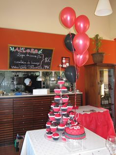 """©Algarve Cakes.  This was a flamenco themed Birthday Cake, it was a choolate sponge 6"""" cake with frills around the base, half of the cupcakes where vanilla sponge and the other half were chocolate. The client provided the cake topper."""