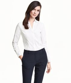White. Fitted, long-sleeved shirt in stretch fabric with V-neck. Buttons at front and at cuffs.