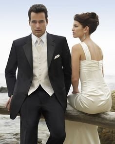 Lovin' the ivory vest and tie with a white shirt and black tux.