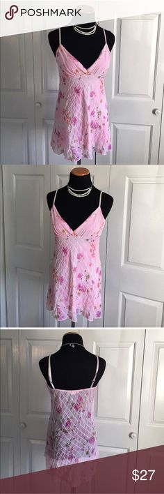 Meghan Noland Tank Light pink tank with floral design by Meghan Noland. Adjustable straps. Tag size is missing, but this is a size small. meghan noland Tops Tank Tops