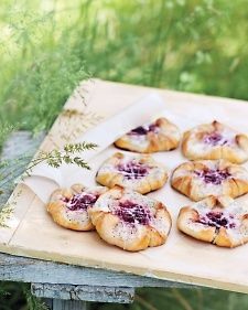 Poppy-seed Danishes with a cream-cheese-and-cherry filling are cut and folded to resemble the blooming flowers/dcc