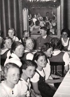 Great Hitler expression in Innsbruck in April, 1938. I bet these babes had interesting diary entries that evening. Looks like Hitler is eating Spätzle based on his plate.