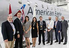 Representatives of Mesa Airlines and Bombardier with the newest CRJ900 aircraft in American Eagle colours