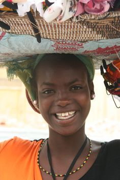 Salesgirl in Dakar, Senegal by 	Ferdinand Reus.