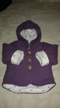 Baby coat, size 12 month, made using merino wool blanket from Faribault Mills and lined with minky fabric. I also used vintage coat buttons from my private collection.