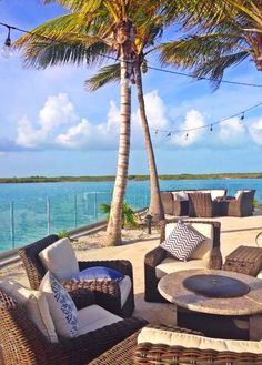 Oceanfront lounging area with firepits at Blue Haven Resort, Turks & Caicos