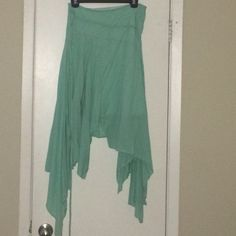 Twirling hi-lo skirt!! Teal colored hi-lo layered skirt. Pin-stripe look. Zipper on the side and decorative string for tying, but not needed to keep the skirt on because the zipper helps the skirt cinch to your waist. Great for salsa dancing Wet Seal Skirts High Low