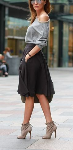 Street chic, off shoulder top, black midi skirt and heels. Latest fall/winter collection.