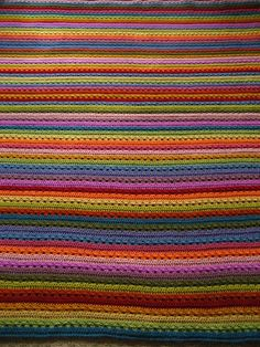 A different patterned stripy crocheted rug.