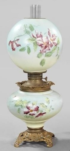 lighting, America, An American reticulated and white opal glass kerosene parlor lamp, Gone with the Wind (type), fourth quarter 19th century, gilded cast-iron-based sky-blue enamel lamp in Primrose decor, retains the blown glass chimney and matching spherical floral-enameled whit opal glass shade