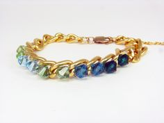 Swarovksi green and blue arm candy  gold chain by AlejandraToro, $17.00