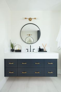 looks clean and sharp, love the round mirror Blue Bathroom Vanity, Navy Blue Bathrooms, Modern Bathroom, Small Bathroom, Black And Gold Bathroom, Bathroom Fixtures, Upstairs Bathrooms, Dream Bathrooms, Beautiful Bathrooms