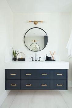 looks clean and sharp, love the round mirror Blue Bathroom Vanity, Navy Blue Bathrooms, Modern Bathroom, Small Bathroom, Black And Gold Bathroom, Bathroom Fixtures, Upstairs Bathrooms, Dream Bathrooms, Beautiful Bathrooms