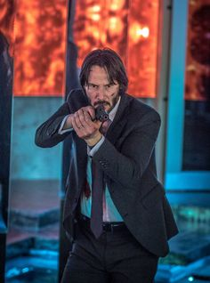 Let's start out the day with some John Wick awesomeness! A new poster has  been released for John Wick: Chapter 2giving us a unique shot from above  looking down on Keanu Reeves holding two pistols with silencers. We've also  included several photos featuring various characters from the film  i