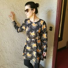 Free People black w/flower print dress Beautiful dress with gorgeous button detail on the sleeves and down the back, hidden zipper down the left side.....100% polyester......tu5 Free People Dresses