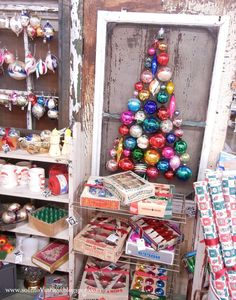 Into Vintage: vintage ornaments - chrsitmas tree on window