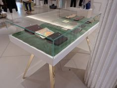 Phillip Lim is a designer who creates everyday classics accented with a sense of madness & this can be seen in the combination of materials used to produce the unique furniture within his stores. With the striking contrast of seamless Corian table top, green mink, 24ct gold legs & glass display case, the table we created compliments the decor & acts as a focal point to the goods it's designed to display, along with plinths which highlight how materials can be combined and layered.