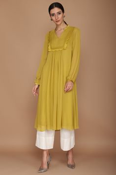 VARUN BAHL Featuring a mustard green kurta in viscose georgette base with cupro satin frills. It is paired with contrasting khada pajama pants in cotton flex base. Dress Indian Style, Indian Fashion Dresses, Indian Designer Outfits, Indian Outfits, Dress Fashion, Dress Neck Designs, Stylish Dress Designs, Designs For Dresses, Blouse Designs