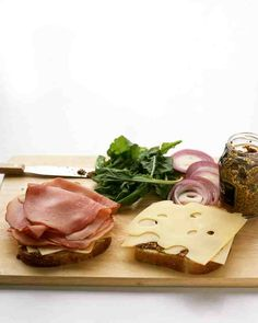 Red onion, arugula, and grainy mustard liven up ham and Swiss cheese sandwiches. Heat the sandwiches on a grill or in a grill pan until toasty.
