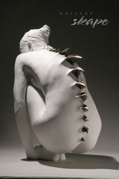 Yoo-Jin Lee is a sculptor from Seoul, South Korea. The artist's series 'Humanoid' fuses characteristics of spiky reptilians with the soft human forms to create a provocative juxtaposition.