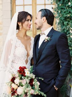 Plunging neckline lace wedding gown: http://www.stylemepretty.com/2016/09/26/multicultural-mexican-arabic-wedding/ Photography: Luna de Mare - http://lunademarephotography.com/