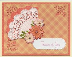 "Quite a while ago I saw a card which featured a fan made out of a small paper doily. I went out and bought some paper doilies and now that they have ""aged"" properly I used one to make this card! Just layered some background papers and added my little ""fan"" made with doily and Nesties scalloped circle punch. (I used a EKSuccess corner punch on the edges of the top background layer.) Then I used a MS sprig punch and some paper flowers to embellish. I stamped a MS label sticker and that ..."
