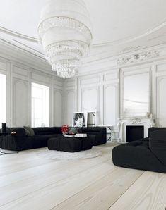 Parisian Apartment- living with large white chandelier and black lounges (itis all in the statement pieces and this chandelier says 'look at me') home-designing.com