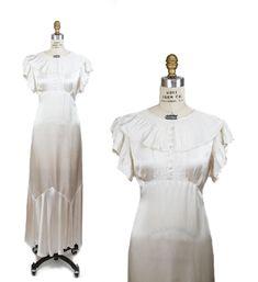 1930s Dress ~ White Satin Ruffle Collar Flutter Sleeve Possible Wedding Dress by GarbOhVintage on Etsy https://www.etsy.com/listing/596210562/1930s-dress-white-satin-ruffle-collar