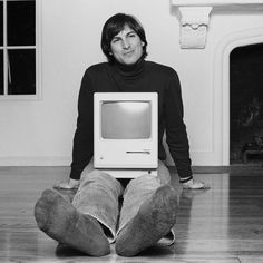 A young Steve Jobs with the first Apple.